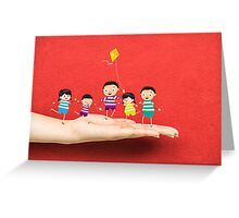 Little children kites on a hand Greeting Card
