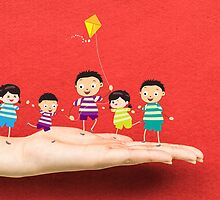 Little children kites on a hand by ngocdai86