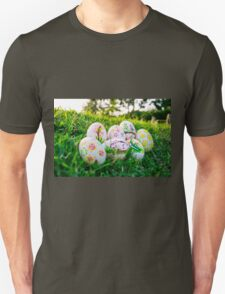 Colorful Easter eggs in a field of grass T-Shirt
