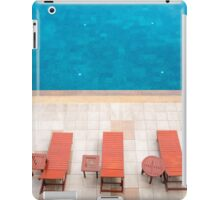 poolside deckchairs alongside blue swimming pool from top view iPad Case/Skin