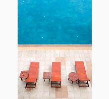 poolside deckchairs alongside blue swimming pool from top view Unisex T-Shirt