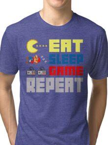 Eat. Sleep. Game. Repeat. Tri-blend T-Shirt