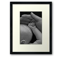 Tiny hand in yours Framed Print