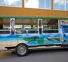Tour bus in Antigua by Keith Larby