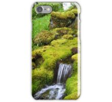 Spring wet green moss covered rocks and green grasses, trees. Nature garden photography. iPhone Case/Skin