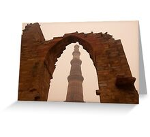 Cross section of the Qutub Minar framed within an archway in foggy weather Greeting Card