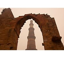 Cross section of the Qutub Minar framed within an archway in foggy weather Photographic Print