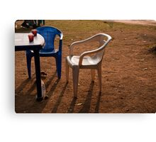Coffee cups along with chairs and tables in a quiet location Canvas Print