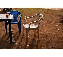 Coffee cups along with chairs and tables in a quiet location Photographic Print