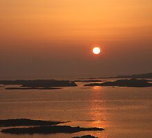 Sunset over Eigg. by John Cameron
