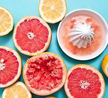 Juicy citruses on the blue by Anna Alferova