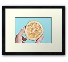 Juicy lemom on a blue background Framed Print