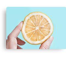 Juicy lemon on a blue background Metal Print