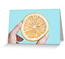 Juicy lemom on a blue background Greeting Card