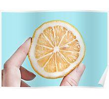 Juicy lemon on a blue background Poster
