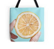 Juicy lemom on a blue background Tote Bag