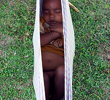Baby sleeping in tea garden nursery by John Mitchell