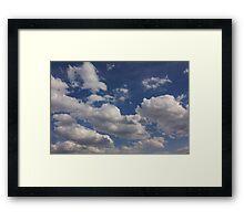 Clouds in blue sky Framed Print