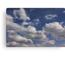 Clouds in blue sky Canvas Print
