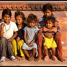 Children at a temple by Shaun Whiteman