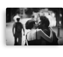 Man and woman kissing in park in black and white analog 35mm film photo Canvas Print