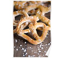 Pile of Salty Baked Bavarian Pretzels on Dark Wood Poster