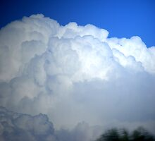 PUFFY CLOUDS by gracestout2007
