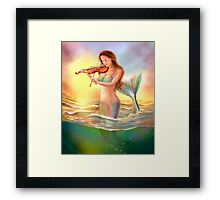 Beautiful  fantasy mermaid plays on violin on sunset Framed Print