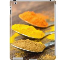 Warm Orange and Yellow Indian Cooking Spices on Silver Spoons iPad Case/Skin