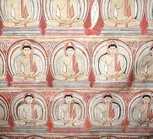 Dambulla Sri Lanka Dambulla Rock temple. Frescoes on the ceilings  in the caves. Rows of Buddha's. by stuwdamdorp