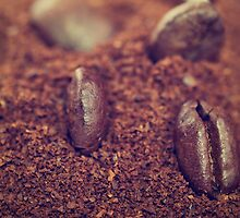 Coffee beans in the heat of the grounded coffee by MartinCapek