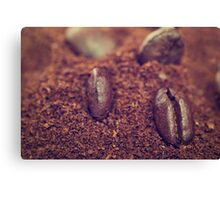 Coffee beans in the heat of the grounded coffee Canvas Print