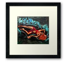 Woman in a red dress holding a flower Framed Print
