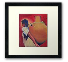 Woman carrying water Framed Print