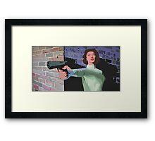 GIRL WITH A GUN Framed Print