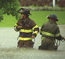 Firefighters rescue stranded motorists by Larry  Grayam
