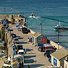 Along The South Pier, Newquay Harbour by Rod Johnson