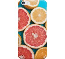 Juicy citruses on a blue table iPhone Case/Skin