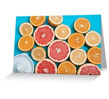 Juicy citruses on a blue table Greeting Card