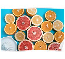 Juicy citruses on a blue table Poster