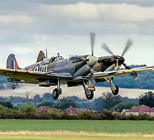Two Spitfires taking off at Duxford by Colin Smedley
