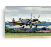 Two Spitfires taking off at Duxford Canvas Print