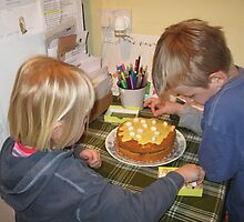 Decorating the Easter cake by naturalimages