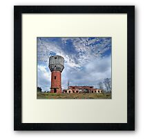 ruins of old water-tower on autumn landscape Framed Print