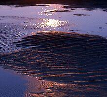 Sun Setting Over Sandy Beach by Helena Haidner