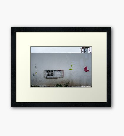 Wall with graffiti Framed Print