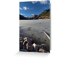 Frozen Smith and MoreHouse reservoir in Utah with log  Greeting Card