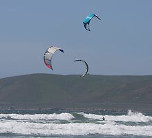 Kitesurfing in the Ocean - Three kites in the distance by Buckwhite