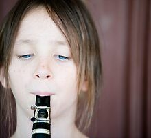 The girl and the clarinet by Alexandre Barreto