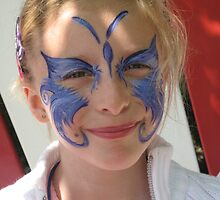 Face paint on a girl in Paris, Disneyland by Rich Clark